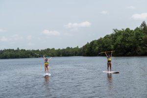 weekend getaway paddle boarding on lake